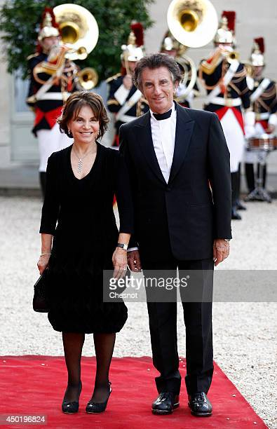 Jack Lang and his wife arrives at the Elysee Palace for a State dinner in honor of Queen Elizabeth II hosted by French President Francois Hollande as...