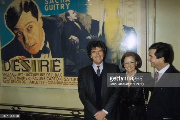 Jack Lang et JeanClaude Brialy visitent l'exposition Sacha Guitry en présence de la productrice Jacqueline Cormier le 30 janvier 1984 à Paris France