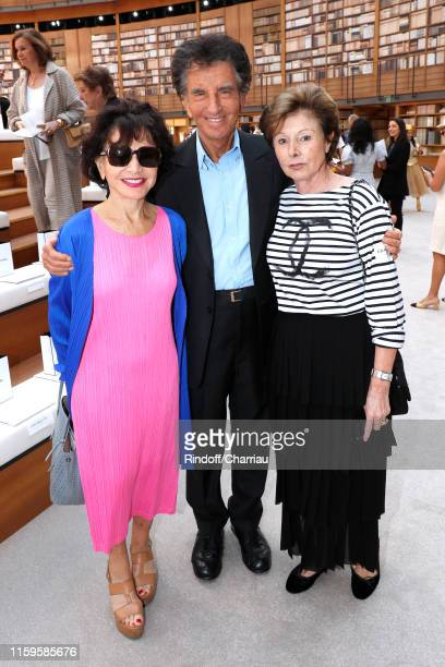 Jack Lang standing between his wife Monique Lang and MarieLouise de Clermont Tonnerre attend the Chanel Haute Couture Fall/Winter 2019 2020 show as...
