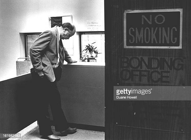 JUN 22 1983 JUN 23 1983 Jack Largent waits at bonding office at the Denver PD to try to bail out Dan McLaughlen