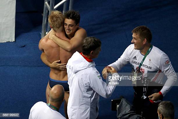 Jack Laugher and Chris Mears of Great Britain celebrate winning gold in the Men's Diving Synchronised 3m Springboard Final on Day 5 of the Rio 2016...
