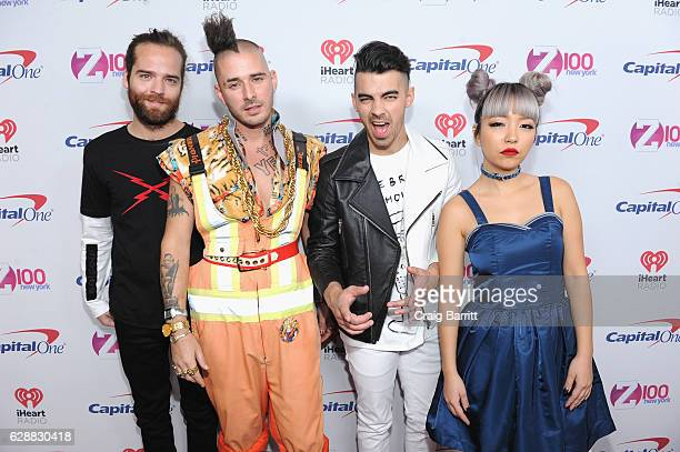 Jack Lawless Cole Whittle Joe Jonas and JinJoo Lee of DNCE attend Z100's Jingle Ball 2016 at Madison Square Garden on December 9 2016 in New York City