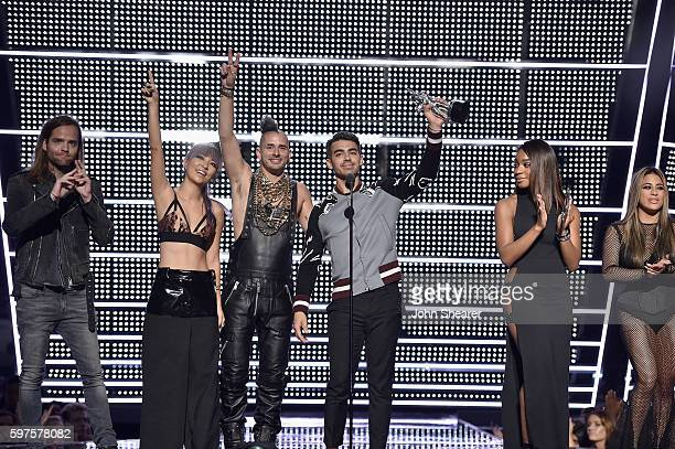 Jack Lawless JinJoo Lee Cole Whittle and Joe Jonas of DNCE accept an award onstage during the 2016 MTV Music Video Awards at Madison Square Gareden...