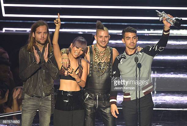 Jack Lawless JinJoo Lee Cole Whittle and Joe Jonas of DNCE accepts the award for Best New Artist onstage during the 2016 MTV Video Music Awards at...