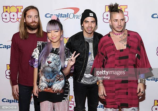 Jack Lawless JinJoo Lee Joe Jonas and Cole Whittle of DNCE arrive at Hot 995's Jingle Ball 2016 at the Verizon Center on December 12 2016 in...