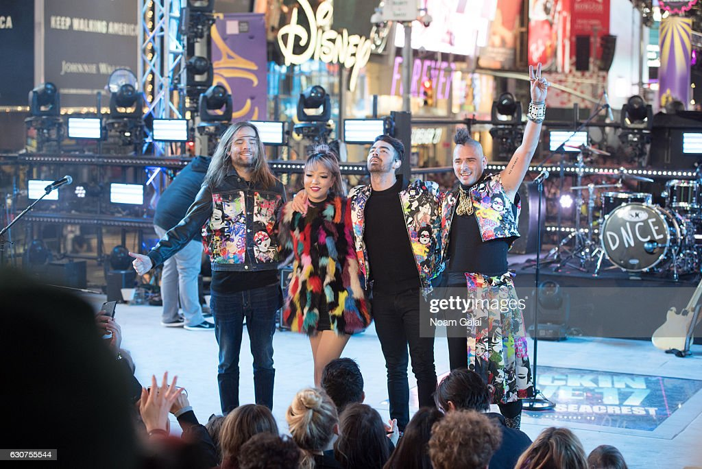 Jack Lawless, JinJoo Lee, Joe Jonas and Cole Whittle of DNCE perform during New Year's Eve 2017 in Times Square on December 31, 2016 in New York City.