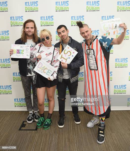 Jack Lawless JinJoo Lee Joe Jonas and Cole Whittle of music group DNCE visit The Elvis Duran Z100 Morning Show at Z100 Studio on April 14 2017 in New...