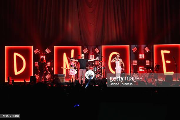 Jack Lawless JinJoo Lee singer Joe Jonas and Cole Whittle of DNCE perform during opening night of the Selena Gomez 'Revival World Tour' at the...