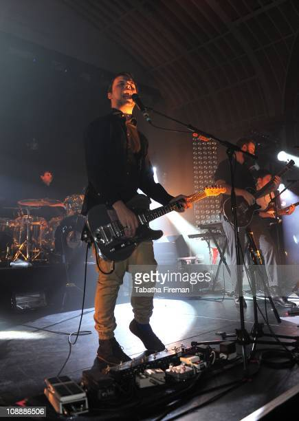 Jack LawrenceBrown Harry McVeigh and Charles Cave of White Lies perform on stage at The Corn Exchange on February 7 2011 in Brighton England