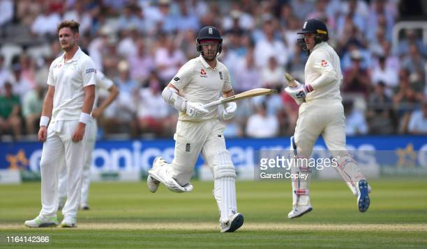 Jack Leach and Jason Roy of England score runs during day two of the Specsavers Test Match between England and Ireland at Lord's Cricket Ground on...