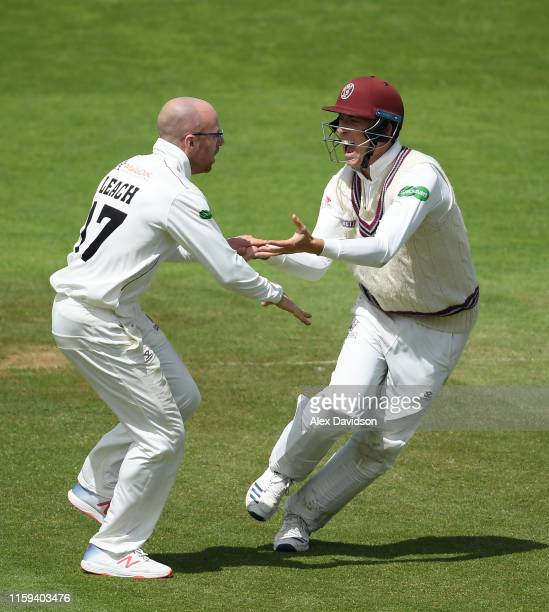 Jack Leach and Tom Banton of Somerset celebrate the wicket of Ajinkya Rahane of Hampshire during Day Two of the Specsavers County Championship...