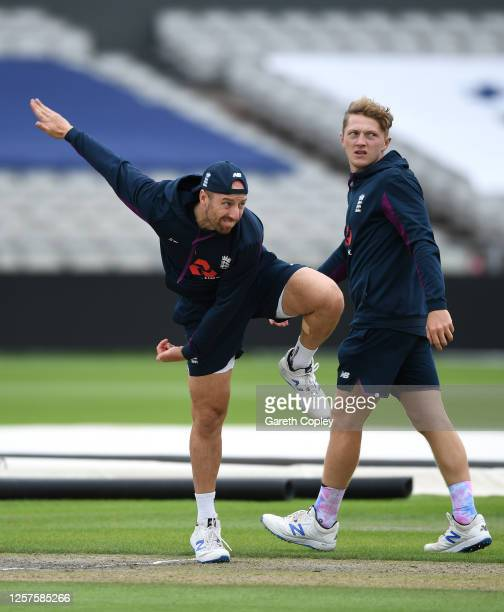 Jack Leach of England bowls watched on by Dom Bess during a England Nets Session at Emirates Old Trafford on July 22 2020 in Manchester England