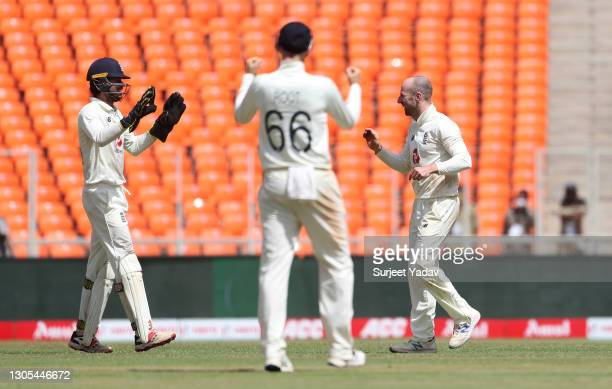 Jack Leach of England celebrates with Ben Foakes after taking the wicket of Ravichandran Ashwin of India during Day Two of the 4th Test Match between...
