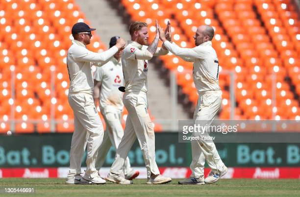 Jack Leach of England celebrates with Jonny Bairstow and Ben Stokes after taking the wicket of Ravichandran Ashwin of India during Day Two of the 4th...