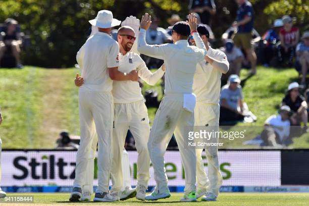 Jack Leach of England is congratulated by team mates after dismissing Ross Taylor of New Zealand during day five of the Second Test match between New...