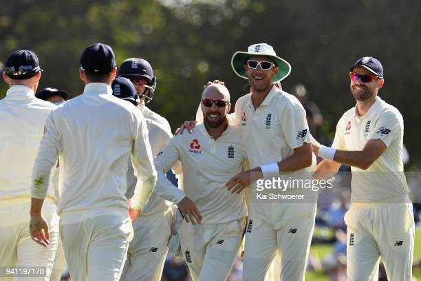 Jack Leach of England is congratulated by team mates after dismissing Tom Latham of New Zealand during day five of the Second Test match between New...