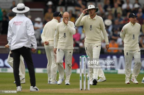 Jack Leach of England looks on with Stuart Broad after Steve Smith returned to bat after a no ball during the fourth Specsavers test match between...