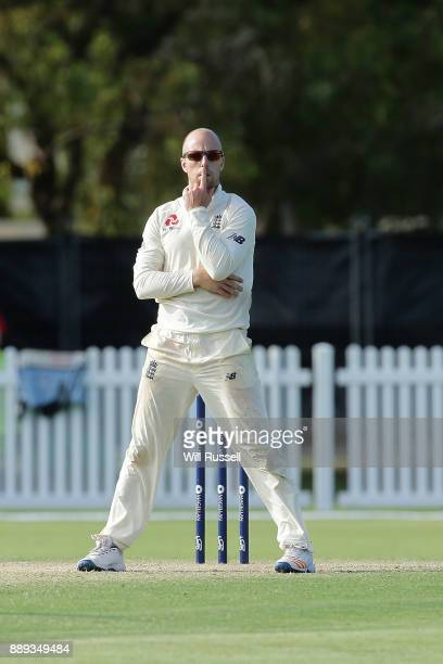 Jack Leach of England ponders after being struck for four runs during the Two Day tour match between the Cricket Australia CA XI and England at...