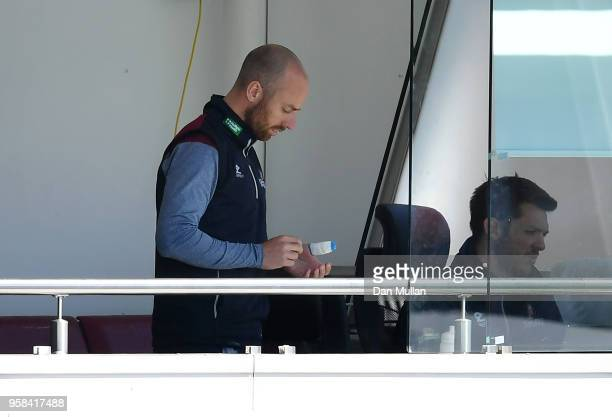 Jack Leach of Somerset appears on the team balcony with his left thumb bandaged after breaking it in the warm up during day four of the Specsavers...