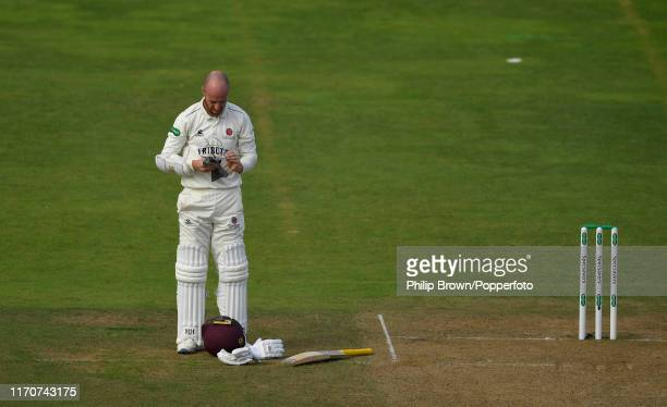 Jack Leach of Somerset cleans his glasses during the second day of the County Championship Division One match between Somerset and Essex on September...