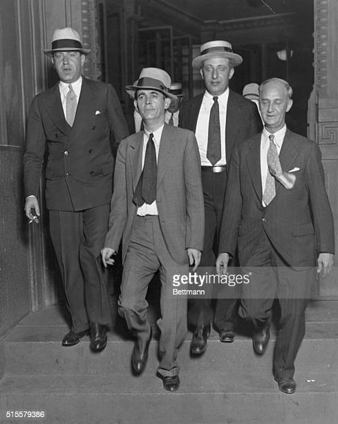 Jack Legs Diamond center and his attorneys leaving Federal Court after being convicted of owning an unlicensed still