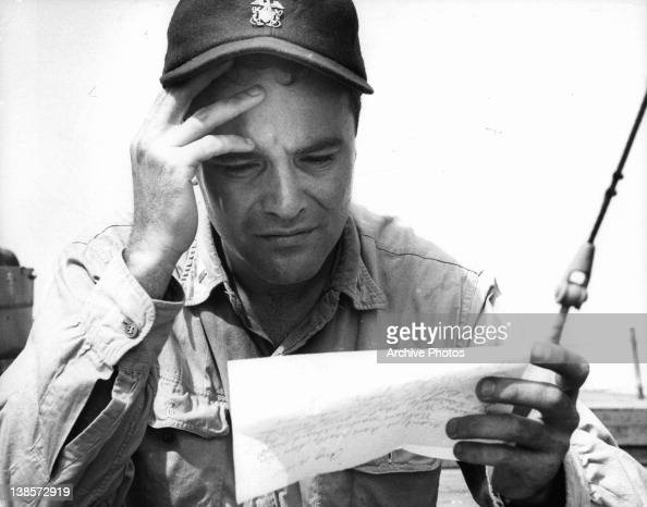 Jack Lemmon reading a letter in a scene from the film 'Mister... News Photo  - Getty Images