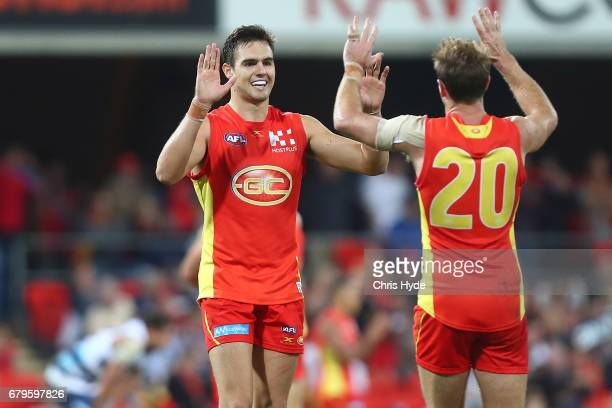 Jack Leslie of the Suns celebrates winning the round seven AFL match between the Gold Coast Suns and the Geelong Cats at Metricon Stadium on May 6...