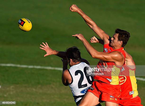Jack Leslie of the Suns contests the ball with Tom Hawkins of the Cats during the NAB Challenge AFL match between the Gold Coast Suns and the Geelong...