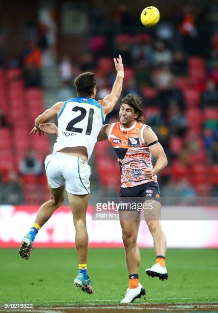 Jack Leslie of the Suns is challenged by Ryan Griffen of the Giants during the round 12 AFL match between the Greater Western Sydney Giants and the...