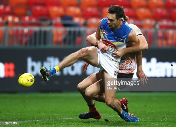 Jack Leslie of the Suns is tackled during the round 12 AFL match between the Greater Western Sydney Giants and the Gold Coast Suns at Spotless...