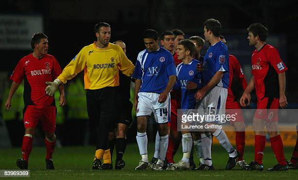 Jack Lester of Chesterfield is confronted by the Droylsden team after scoring an unsportsmanlike goal during the FA Cup Second Round Match between...