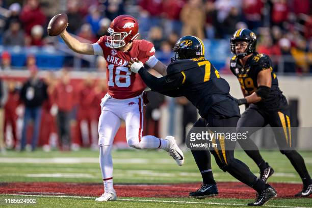 Jack Lindsey of the Arkansas Razorbacks tries to get away from the tackle of Kobie Whiteside of the Missouri Tigers in the second half of a game at...