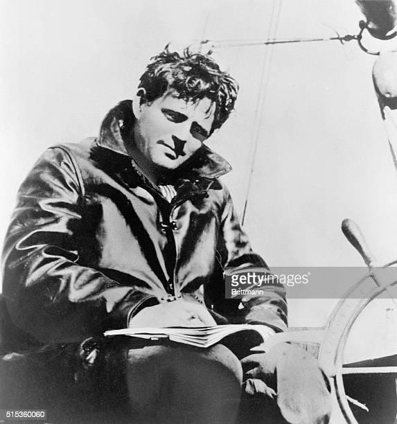 Jack London American novelist and shortstorywriter writing aboard ship Undated photograph