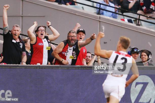 Jack Lonie of the Saints celebrates a goal with fans during the round 5 AFL match between Melbourne and St Kilda at Melbourne Cricket Ground on April...