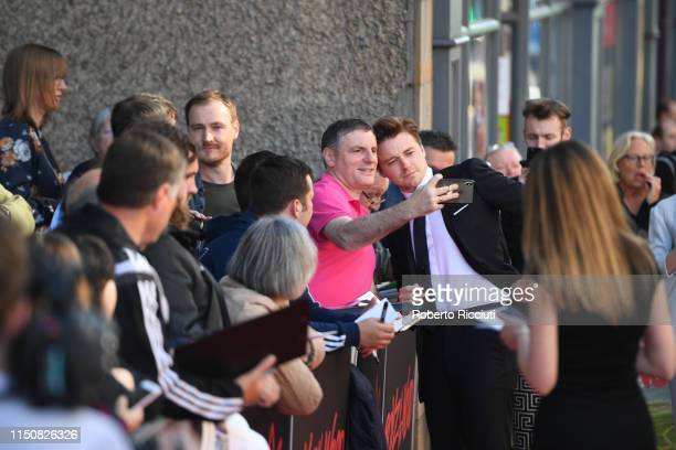 Jack Lowden takes a selfie with a fan during the European premiere of Boyz In The Wood and opening night gala of the 73rd Edinburgh International...