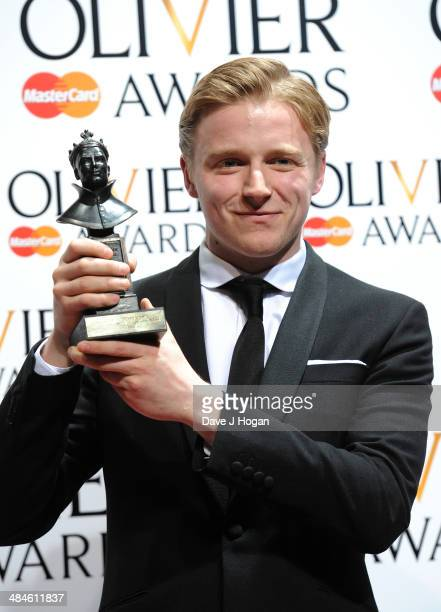 Jack Lowden with his Best Actor in a Supporting Role award for Ghosts during the Laurence Olivier Awards at the Royal Opera House on April 13 2014 in...