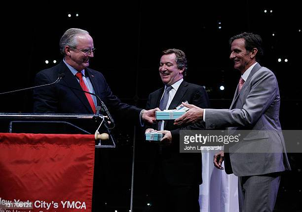 Jack Lund , Tom Carroll and Matthew O'Grady attend the YMCA of Greater New York's Arts & Letters auction and reception at the Frederick P. Rose Hall,...