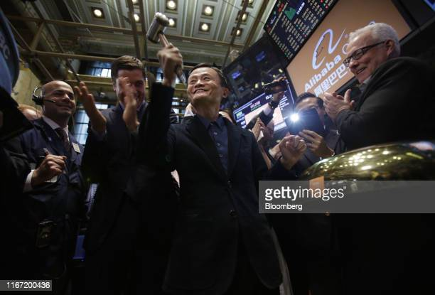 Jack Ma, billionaire and chairman of Alibaba Group Holding Ltd., center, rings a bell during the IPO ceremony on the floor of the New York Stock...