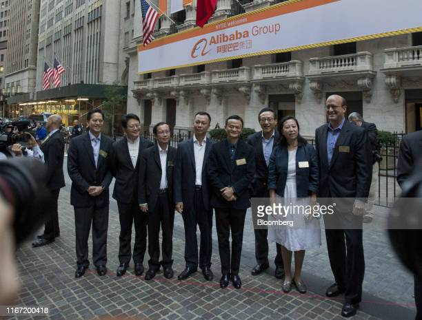 Jack Ma billionaire and chairman of Alibaba Group Holding Ltd fourth right stand for a photograph with Peng Jiang deputy chief technology officer of...