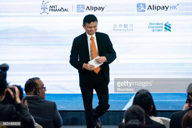 Jack Ma chairman of Alibaba Group Holding Ltd leaves the stage after speaking at a news conference in Hong Kong China on Monday June 25 2018...