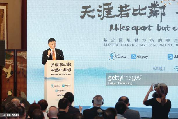 Jack Ma chairman of Alibaba Group speaks at the ceremony to launch a blockchainbase remittance solution in Hong Kong Monday June 25 2018 Users of...