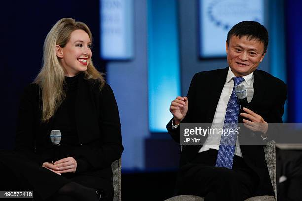Jack Ma Executive Chairman of Alibaba Group speaks on stage as Elizabeth Holmes listens during the closing session of the Clinton Global Initiative...