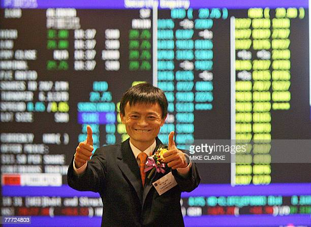 Jack Ma founder and chairman of Alibabacom gives a thumbs up to the press at the Hong Kong Stock Exchange 06 November 2007 Shares in Chinese online...