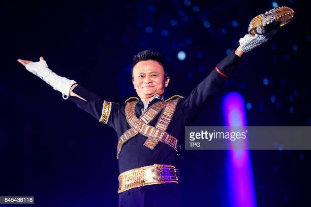 Jack Ma founder and chairman of China's ecommerce giant Alibaba dresses as Michael Jackson and dances in the Alibabasannual party celebrating the...