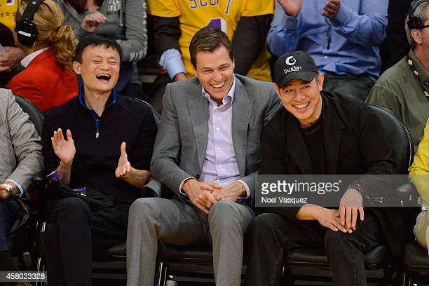Jack Ma, Patrick Whitesell and Jet Li attends a basketball game between the Houston Rockets and the Los Angeles Lakers at Staples Center on October...
