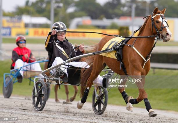 Jack MacKinnon drives Harry in the Kidz Kartz NZ Trotting Cup during Lindauer Race Day at Addington Raceway on November 13 2009 in Christchurch New...