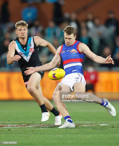 Jack Macrae of the Bulldogs kicks the ball during the 2021 AFL Second Preliminary Final match between the Port Adelaide Power and the Western...