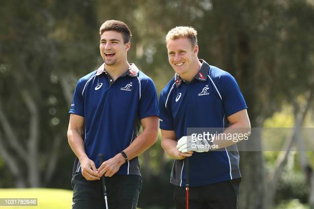 Jack Maddocks and Reece Hodge watch the tee offs at Royal Pines Resort on September 12 2018 in Gold Coast Australia