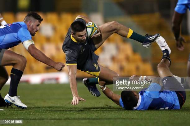 Jack Maddocks of Cheika's Choice is tackled during the Wallabies Internal trial match between Cheika's Choice and the Australian Super Selection at...