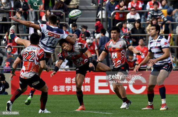 Jack Maddocks of Rebels battles for the ball with Ryuji Noguchi of Sunwolves during their Super Rugby match between Japan's Sunwolves and Australia's...